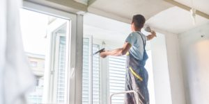 image of popcorn or stucco ceiling removal and repair being performed by JD MacGillivray Painting and Decorating of Newmarket, Aurora, King City, Richmond Hill and Markham